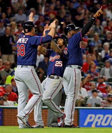 TWINS SEEING DOUBLE:    Minnesota Twins' Chris Gimenez, left, Byron Buxton, center, and Kennys Vargas celebrate scoring on a bases-clearing double by Brian Dozier in the fifth inning against the Texas Rangers on April 24 in Arlington, Texas. The Twins won 3-2.