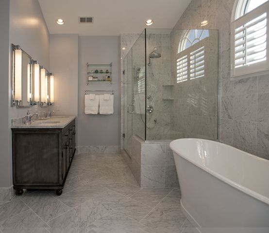 Master Bathroom features from floor to ceiling our Bianco Venatino in various sizes. ...