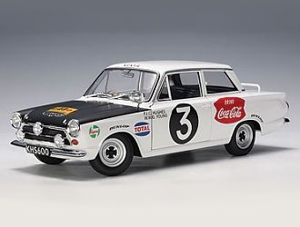 This Ford Cortina MkI (Peter Hughes - East African Safari Winner 1964) Diecast Model Car is White and features working steering, suspension, wheels and also opening bonnet with engine, boot with spare wheel, doors. It is made by AUTOart and is 1:18 scale (approx. 23cm / 9.1in long).    Driven by Peter Hughes and Bill Young....