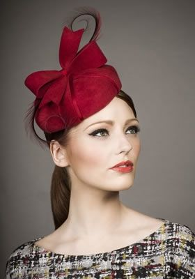 Rachel Trevor Morgan, A/W 2013 - Red felt parcel pillbox with red pheasant feather curls.