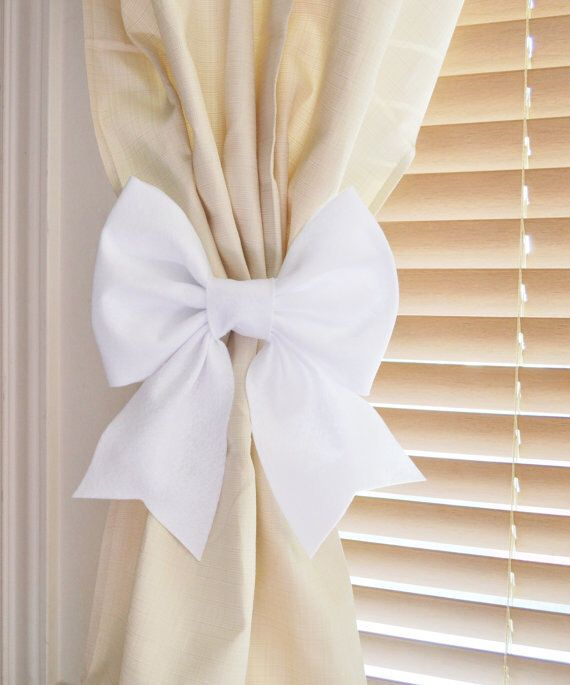 Two White Bow Curtain Tie Backs. Decorative Tiebacks Curtain Holdback -Drapery Tieback- Baby Nursery Decor. Cottage Chic. by bedbuggs on Etsy https://www.etsy.com/listing/156699527/two-white-bow-curtain-tie-backs