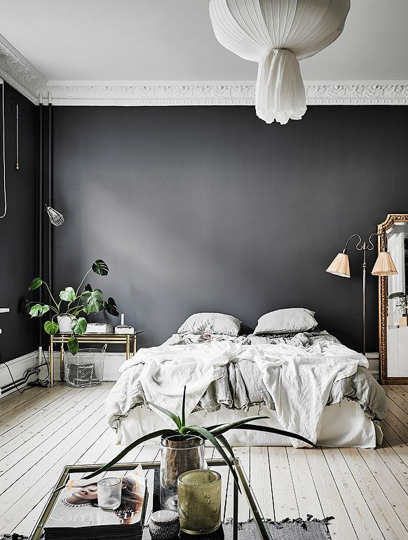 Black walls in this bedroom give it a surprisingly cosy look and without taking away from the light and airy spacious feeling.