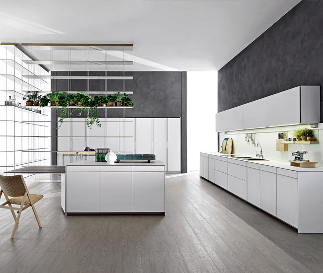 Molteni & C's sister brand Dada, is a leading manufacturer of kitchen systems. Vela (shown) is by designer Dante Bonuccelli.