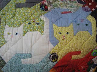 tesselating cats quilt - years ago I bought a pattern similar to this with the cat holding a ball..never did it....oh, where is that pattern now, do I still have it???