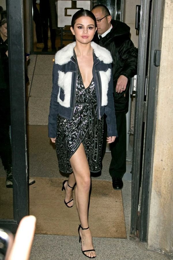 Selena Gomez has been sporting one sleek look after another as of late—rapidly positioning herself atop our best-dressed list. An embellished denim jacket lends cool-factor to a beaded frock.