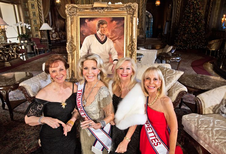 FANFARE FOR THE ORANGE MAN Founding Trumpettes Terry Ebert-Mendozza, Toni Holt Kramer, Janet Levy, and Suzi Goldsmith, photographed in the living room of Mar-a-Lago with the painting The Visionary, by Ralph Wolfe Cowan. Photograph By Harry Benson.