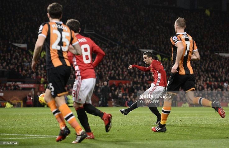 Manchester United's Armenian midfielder Henrikh Mkhitaryan shoots but fails to score during the EFL (English Football League) Cup semi-final football match between Manchester United and Hull City at Old Trafford in Manchester, north west England on January 10, 2017. / AFP / Oli SCARFF / RESTRICTED TO EDITORIAL USE. No use with unauthorized audio, video, data, fixture lists, club/league logos or 'live' services. Online in-match use limited to 75 images, no video emulation. No use in betting…