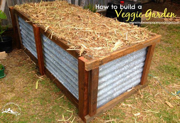 How to build a veggie garden: Very simple tutorial on how to build a veggie garden using recycled materials. This backyard raised garden bed is made from corrugated tin with a wood frame. Grow your own vegetables and produce in your backyard to be more sustainable www.mybrownpaperpackages.com