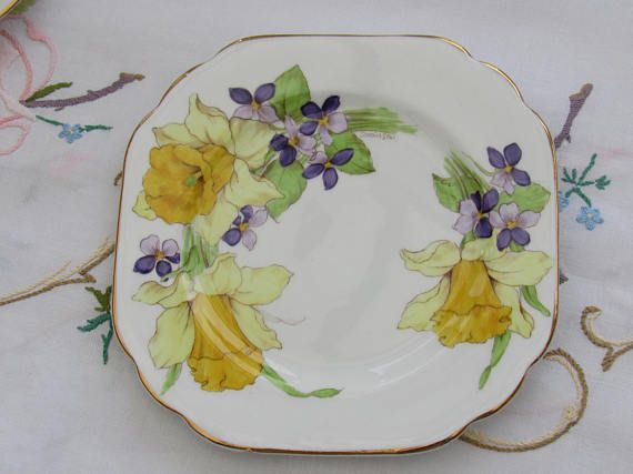 The most wonderful Stanley bone china tea cup trio. This pretty Daffodils set is hand painted and signed by the artist on each piece with the name Robinson. This is a stunning set and in good condition. Decorated on every side with daffodils and violets it is a real sight to
