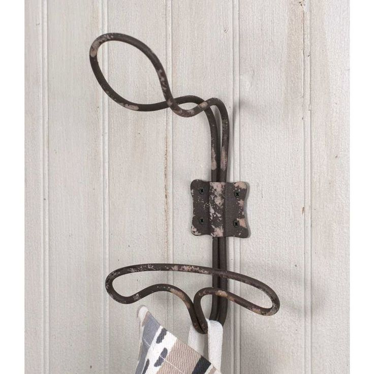 "Add a rustic touch to any room in your home with this wire locker room hook. This hook has an aged patina. Hook measures 3½""W x 3¾""D x 6""T. Orders ship within two business days."