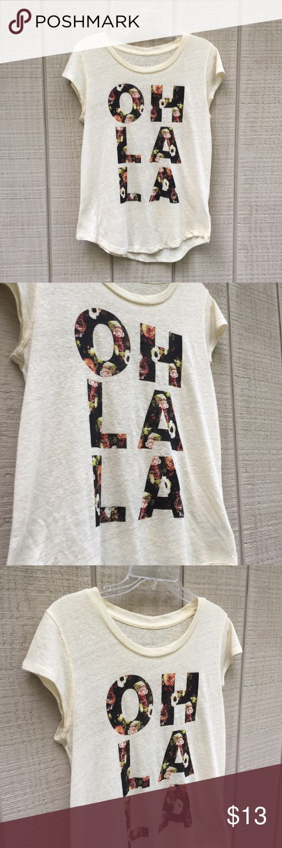 """Merona OH LA LA graphic floral appliqué tee, M This adorable Merona top channels a preppy summer vibe with its light cream base and bold floral appliqué """"OH LA LA"""" graphic. Material is a 56% linen, 44% polyester blend - material is slightly see-through, and naturally textured. Pre-owned, but in fantastic condition! Remember to bundle with other items from this closet to receive 15% off your purchase and to save on shipping! Merona Tops Tees - Short Sleeve"""