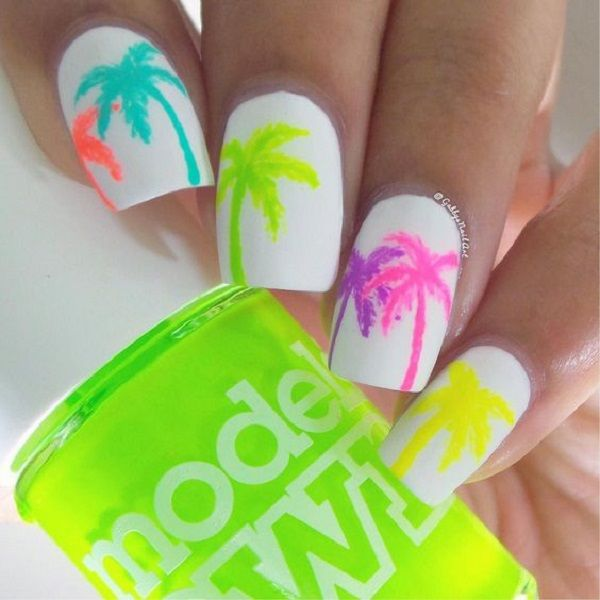 A simple Palm Tree Nail Art design. You can never go wrong with white. The white polish is used as the background while the palm trees are painted with different bright colors on top.