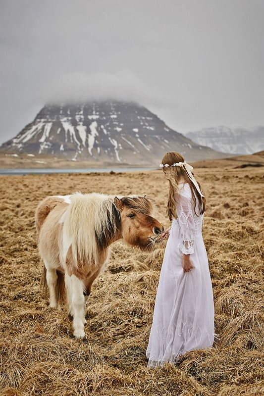 Photographed Amber on her wedding day, she was very keen to meet some Icelandic horses so when we saw these by the road we of course had to stop. That is Kirkjufell in the backround. Photo by Lárus Sigurðarson.