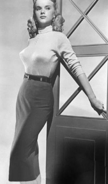 1950s in-style. (As it seems, they weren't called bullet bras then, just the in-style bras...)
