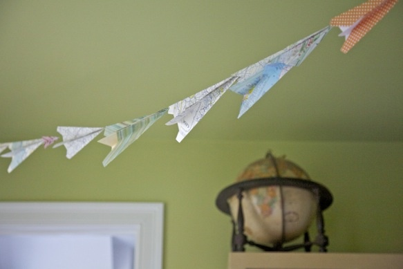 paper airpane streamer in the bedroom.