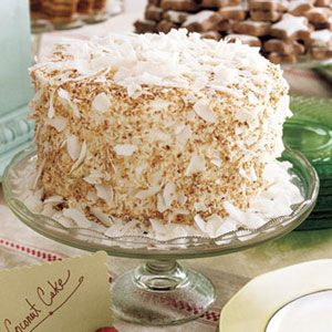 Coconut Cake Layers of rum syrup are hidden within this toasted coconut confection.