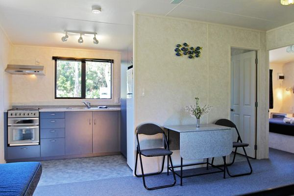 Bungalow | Russell - Orongo Bay Holiday Park  Full kitchen with oven, hotplates, fridge, microwave, crockery and cutlery. En-suite Bathroom.
