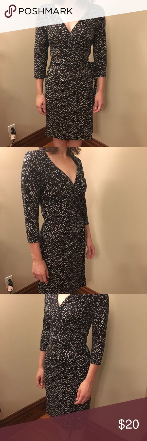 """Ann Taylor Wrap Dress Size large wrap dress in excellent condition. Heavy enough to wear in fall or winter. Very cute with tights and leather boots. Model is 5'7"""" and 140 pounds Ann Taylor Dresses"""