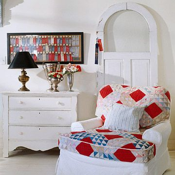 Comfy chair upholstered with a quilt -- love this, and the framed ribbons