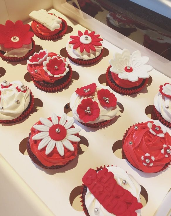 Red and white flower cupcakes! Very elegant! Lovely gift!  Check out my page https://www.facebook.com/frosted.cupcakes.invercargill/