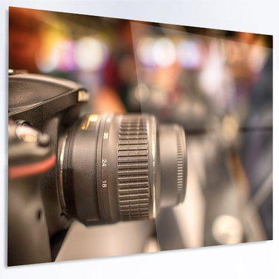"DesignArt 'Modern Camera in City Electronics Shop' Photographic Print on Metal Size: 12"" H x 28"" W x 1"" D"