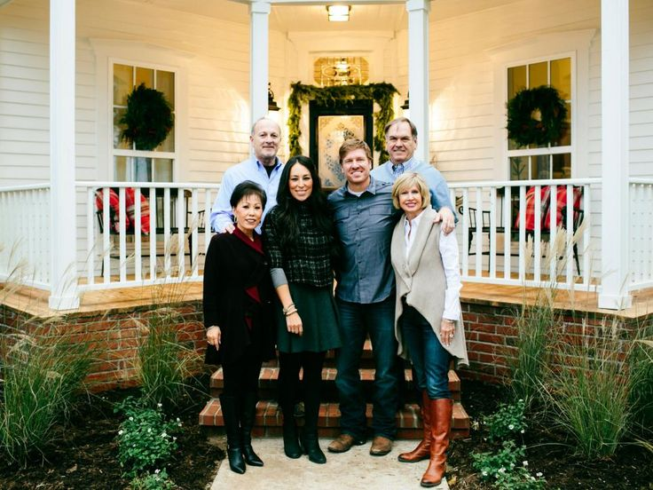 Chip and Jo pose with their parents at Magnolia House, their newly renovated bed-and-breakfast (featured on HGTV's Fixer Upper holiday special)