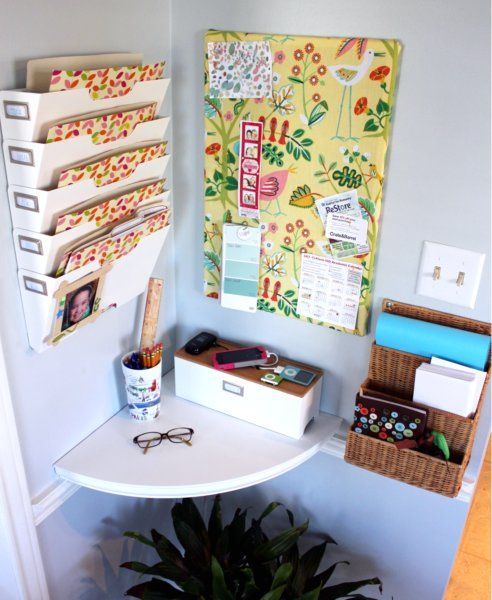 Use your extra space to get organized by building a central spot that fulfills all of your family's needs. Hi Sugarplum! added a phone charger, memo board, and plenty of useful (and pretty) storage. Get the how-to »   - HouseBeautiful.com