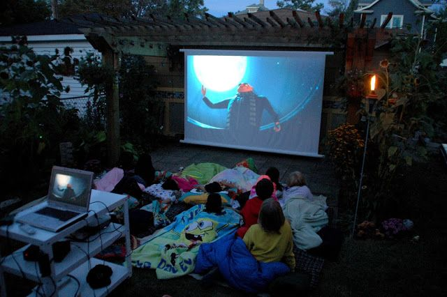 How to hang a backyard movie screen! Our Tiny Oak Park Bungalow