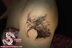 Grey Ink Eagle Head Tattoo On Left Shoulder