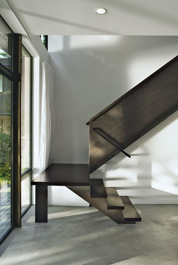 On the sandy shores of Fauntleroy Cove in Seattle, renowned firm Olson Kundig Architects crafts a subtle home with striking steel accents. Steel allowed Kunding to be playful with the staircase's form. | Dwell