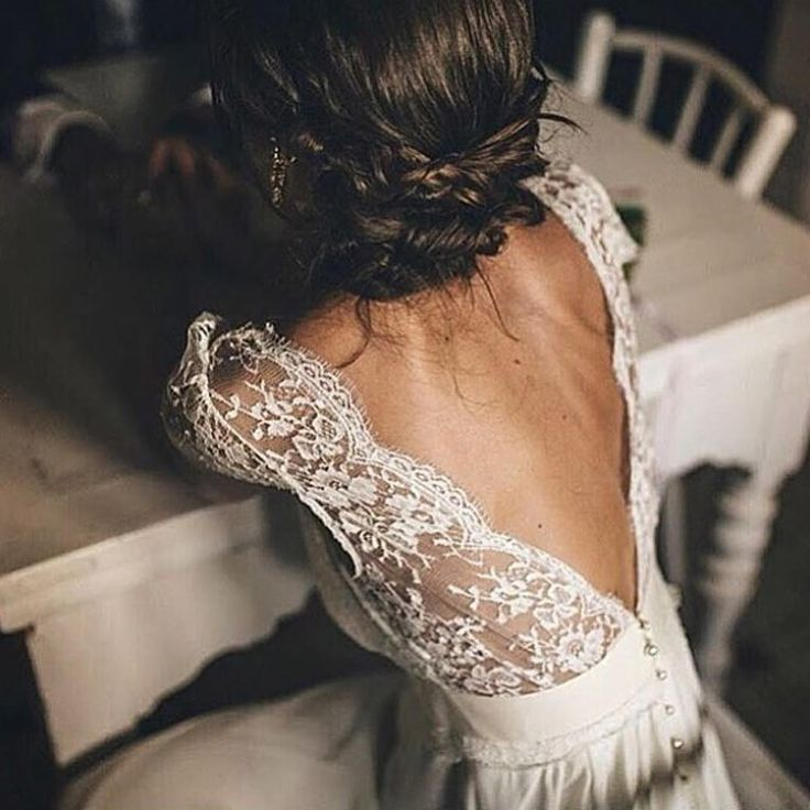 Loving the V shape on the back of lace this wedding dress. The braided updo is the perfect compliment and giving so much 2018 wedding inspiration!  See another bride with a beautiful V shaped back on her wedding gown here: https://rachelehphotography.com/2017/09/27/keswick-vineyards-autumn-wedding-kim-mike/