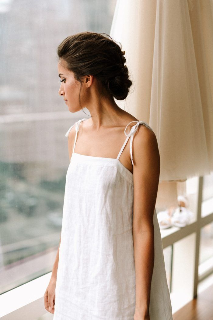 Super sweet getting ready look featuring an elegantly braided chignon | image by Laura Rowe Photography   #weddingphotoinspiration #weddingphotoideas #weddingphotoinspiration #weddingdress #bridalportrait #bridalstyle #bridalfashion #bridalinspo #bridalinspiration #bride #bridalhair #bridalhairstyle #bridalmakeup #gettingreadyinspo