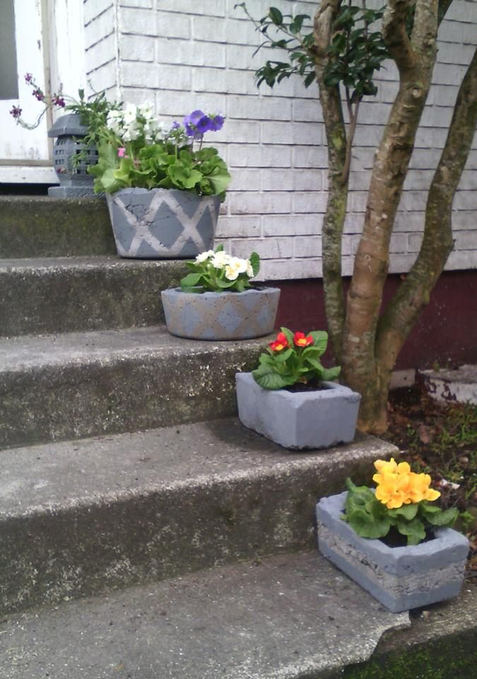 These are my first 4 attempts at making concrete planter pots.  I brought Quick Set concrete that starts to set with in minutes. I just mixed smallish amounts at a time. I found the more water I used the smother the final look was. I painted them using 1 can of grey primer spray paint.