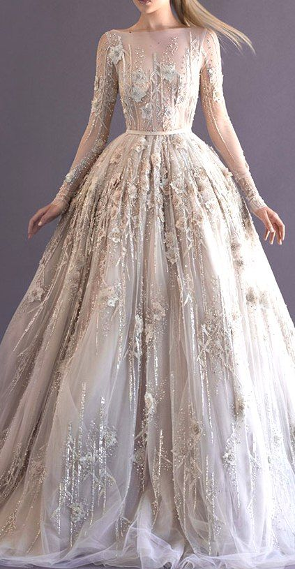 Paolo Sebastian sleeved lace  gown encrusted with a million dollars worth of diamonds and 3D flower petal detail.