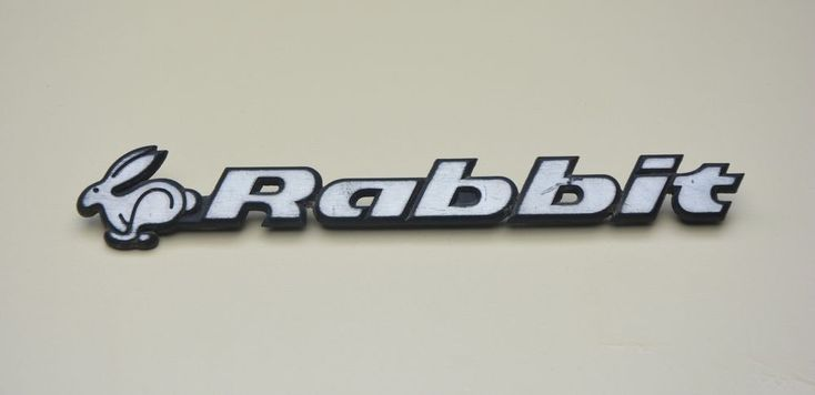 USED VW RABBIT EMBLEM LOGO  PLASTIC REAR BADGE  #VW