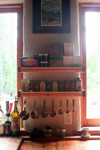 Vertical space, accessible storage, hanging measuring cups.  Cute and functional design.