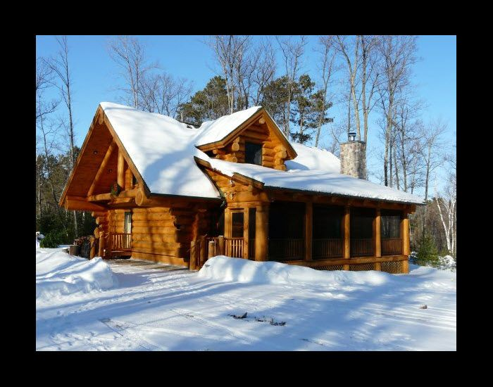 handcrafted log cabin with sunroom