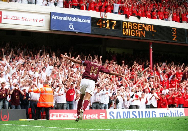 Stuart MacFarlane Thierry Henry 2nd Goal v Wigan Thierry Henry celebrates scoring Arsenal's 3rd and his 2nd goal of the match. Arsenal 4:2 Wigan Athletic. FA Premiership. Arsenal Stadium, Highbury, 7th May 2006. Copyright : Stuart MacFarlane / Arsenal Football Club.