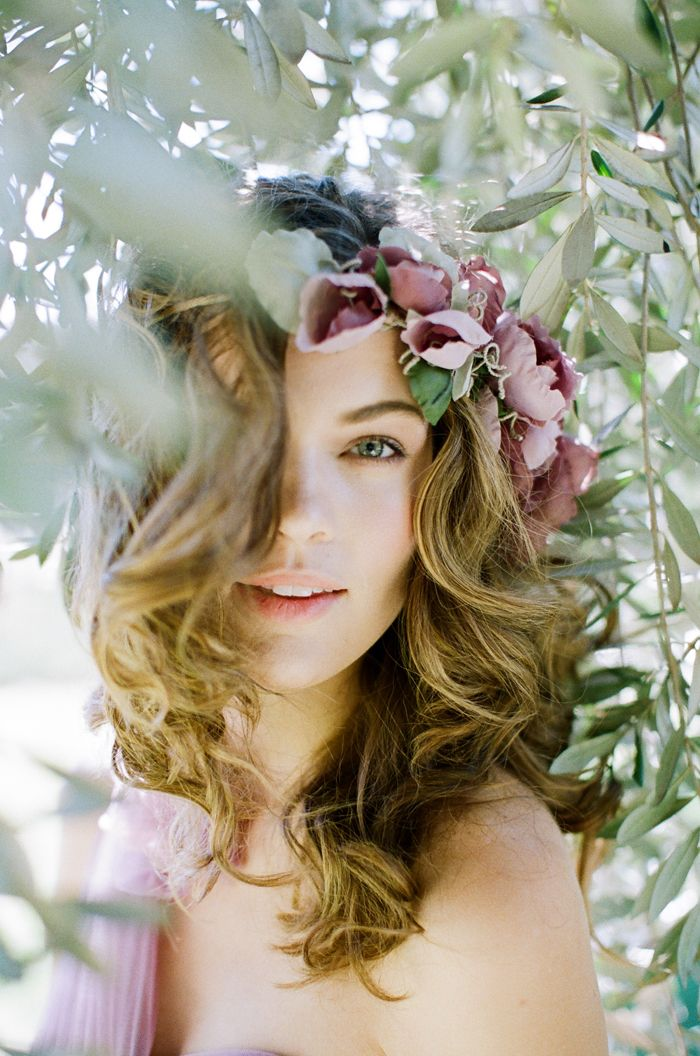 I would love to pull off this look, soft and full curls with an off center flower crown, and natural/minimal makeup!