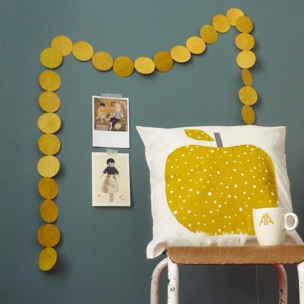 there is something so quirky about this color combination and the apple pillow/old photos.