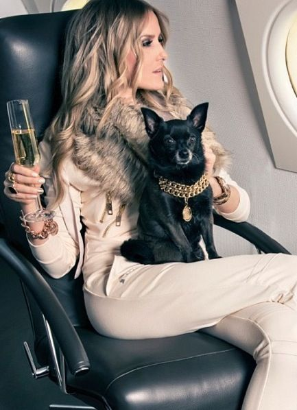 -In her private jet - Love the dog collar too <3