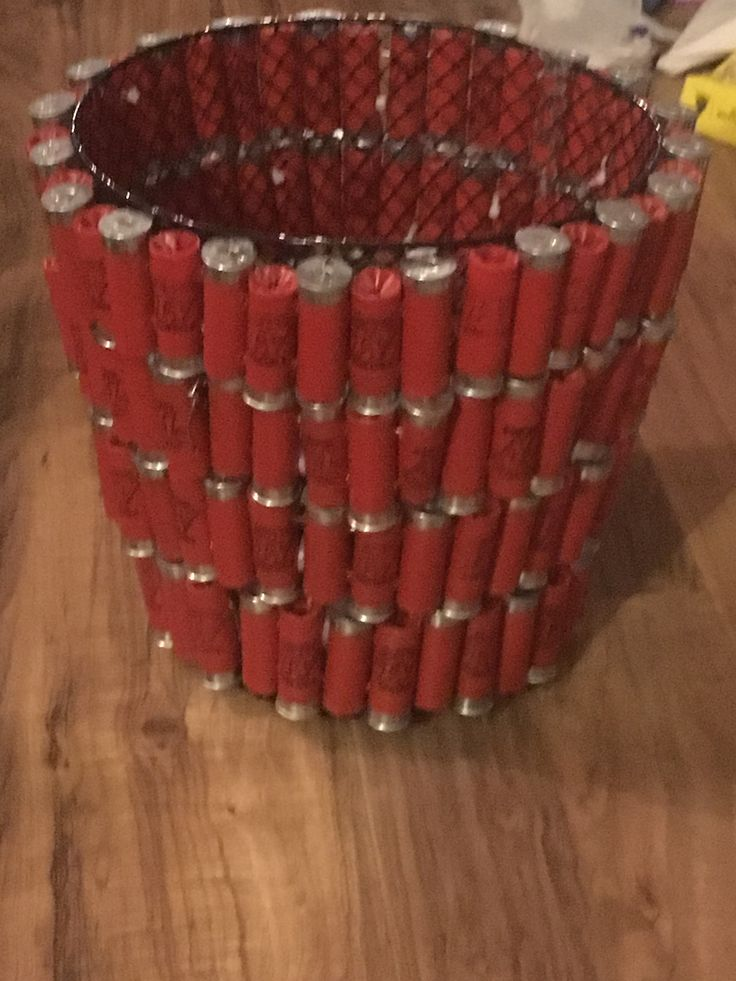 Trash can made from shotgun shells.
