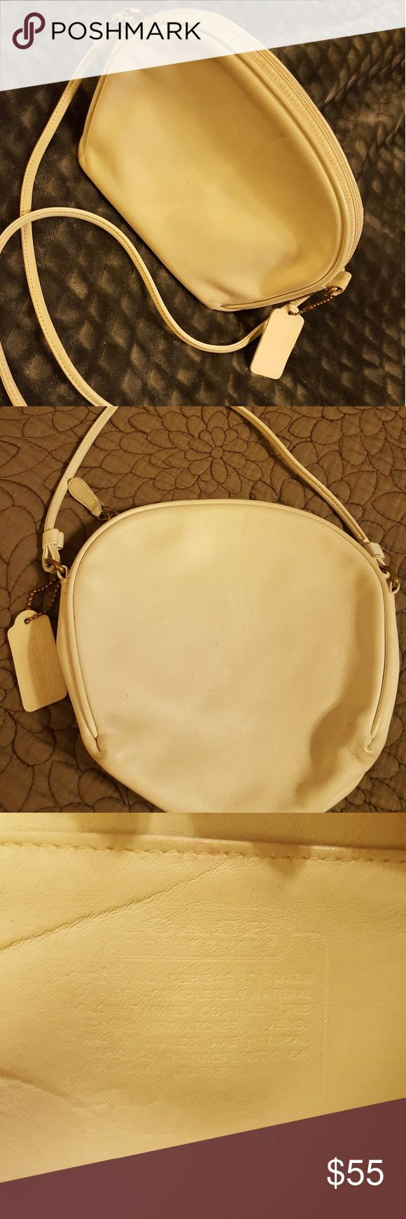 Vintage, authentic Coach purse. Adorable, round, white leather purse. One owner, smoke free home. Inside has a couple little spots, and Coach tag is slightly split but otherwise great condition! COACH Bags Shoulder Bags