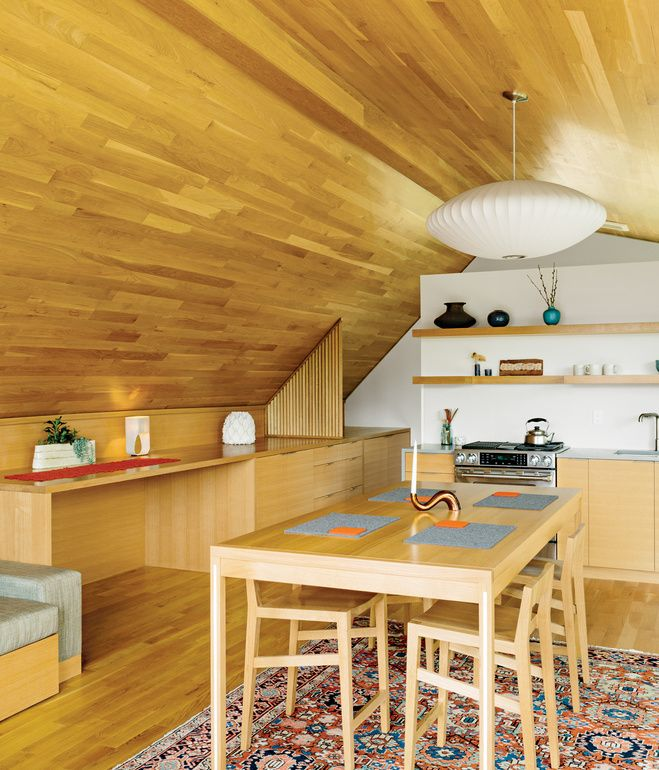 Strips of white-oak flooring line the interior of the studio, created by designer Jeff Vincent and PATH Architecture. The George Nelson B...