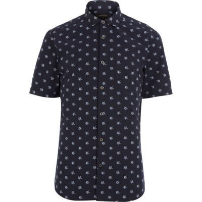 Navy star print short sleeve shirt in River Island.