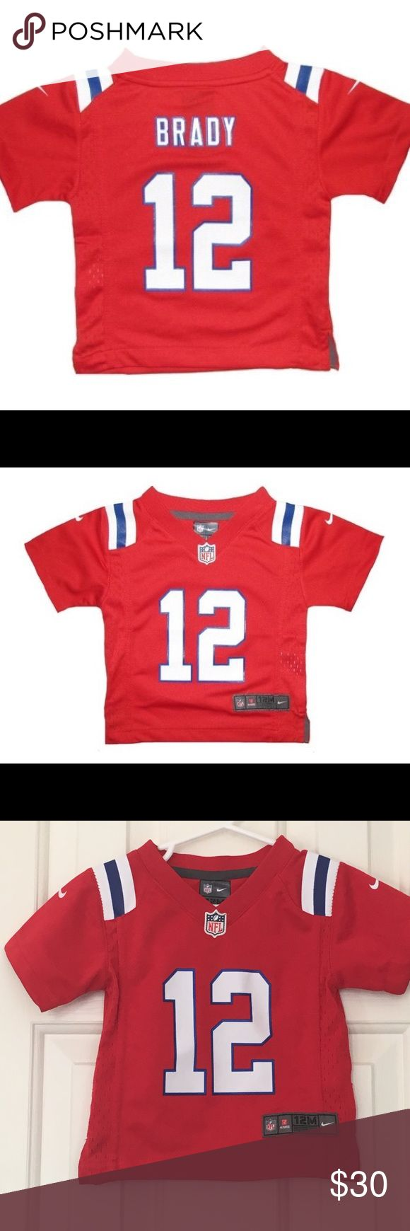 Infant Nike Tom Brady Throwback Jersey-Red The Infant Nike Tom Brady Throwback Jersey-Red is the perfect game day jersey for your littlest Patriots fan! This Nike jersey is a scaled down version of the kids and adult Nike jerseys, featuring the same New England Patriots throwback jersey design. Great condition. Nike Shirts & Tops Tees - Short Sleeve
