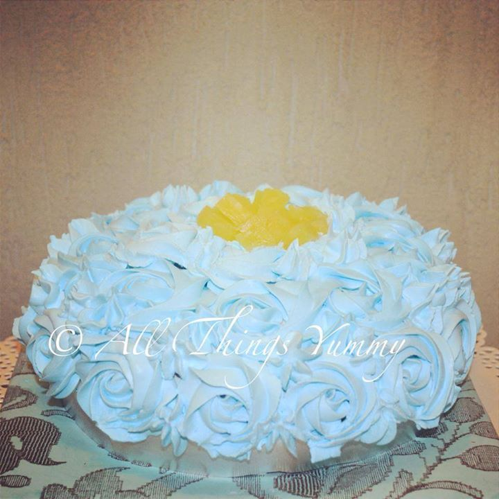 Cakes Decor Rosettes - A Pastel Blue Rosettes Decor Cake with Pineapple | All Things Yummy #allthingsyummy #pink #rosettes #cake #icing