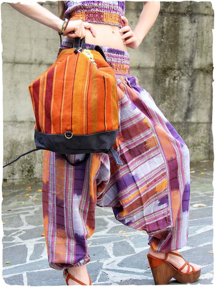 Olgado trousers Ample #trousers with #elastic in belt.  Jessy #ethnicrucksack  ethnic #rucksack handmade with manta #Cuzco fabric and eco leather. The ethnic fabric, close to the muted colours of eco leather stands out even more for her beauty and workmanship.Small keychain included.