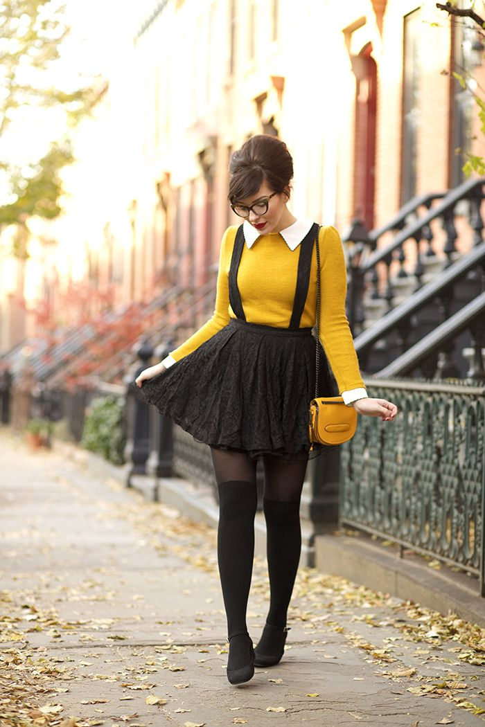 I love the little collar peeping out, the splash of color, the suspenders, and the tights. Essentially everything.