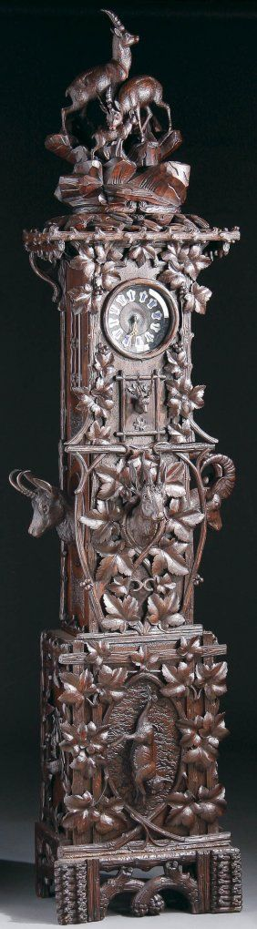 "A HIGHLY ORNAMENTED ""SWISS CARVED"" BLACK FOREST TALL CASE (GRANDFATHER) CLOCK circa 1900"